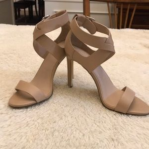 Charles size 8 criss-cross buckled heeled sandals.